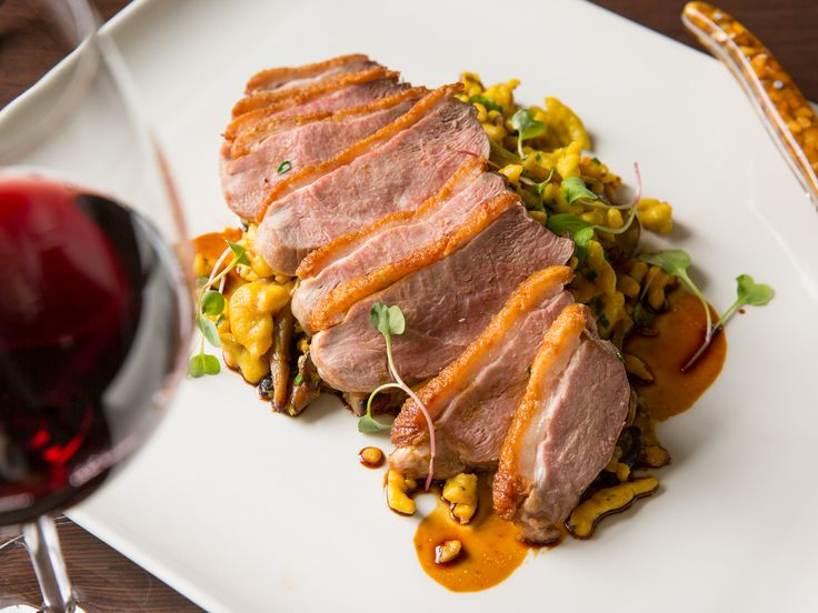 Crescent Duck Farm's #DuckBreast with pumpkin spaetzle, wild mushrooms, bacon lardons, sweet caramelized onions, and herbs