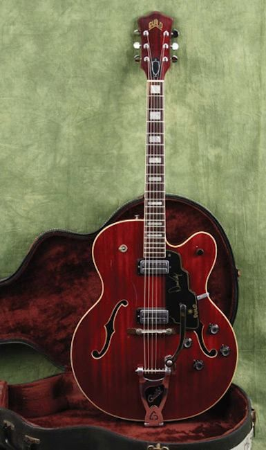 This 1969 Guild Guitars Duane Eddy 400 is a semi-hollowbody with a bound, arched spruce top, maple back and sides, mahogany neck, and a 20-fret bound rosewood fretboard.