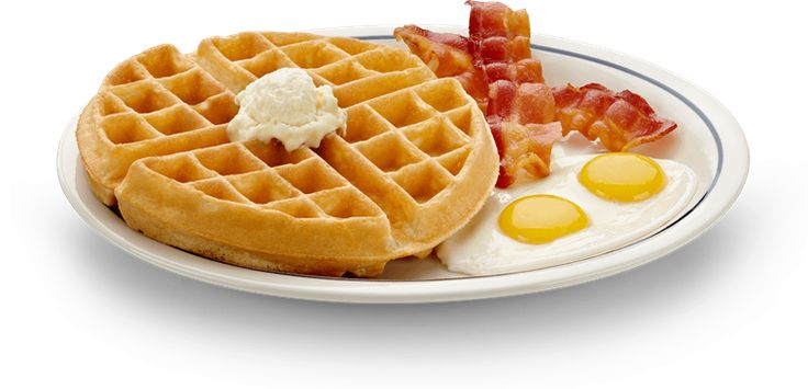 A Belgian waffle crowned with fruit topping and served with two eggs and bacon on the IHOP Waffle menu.