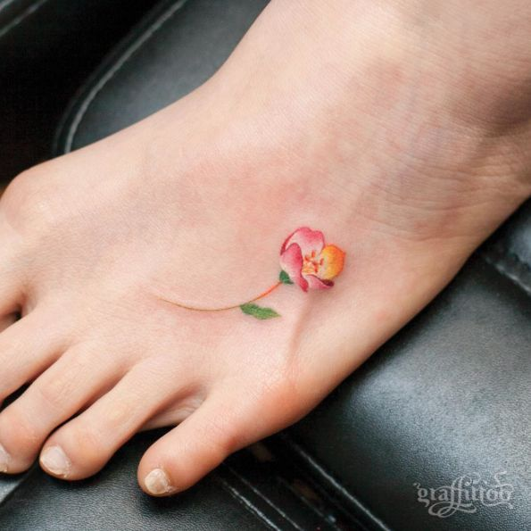 Tiny Floral Foot Tattoo by Graffittoo