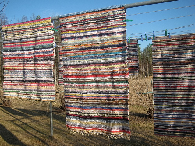My Grandmother made Finnish Rag Rugs on her loom in our basement.  I helped Cut the rags, wrap the warp & sat on the bench as she pounded each row tightly into place.  I wish she was around to teach me that ART!