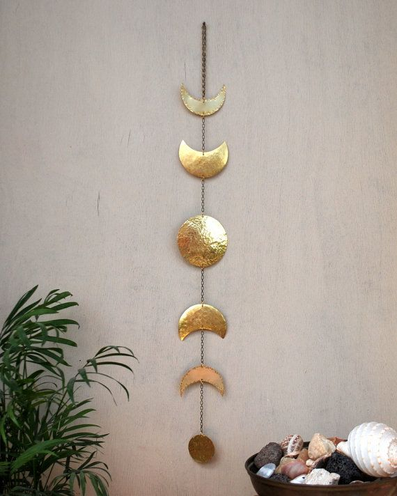 This unique moon phases brass wall hanging is shiny and vibrant and works with more classic decor as well as colorful decor. It looks beautiful hanging on a wall or on a cupboard. Each of the elements is hammered differently and the big full moon in the centre is a bit rounded to give it a 3d appearance.  Approximate size: Length 23 /58.5cm Wide 2.7/ 6.9cm SPECIAL EXPRESS shipping for these countries: USA ~ CANADA ~ BELGIUM ~ UK ~ SPAIN ~ SWITZERLAND ~ GERMANY ~ HOLLAND ~ SWEDEN ~ FRANCE…