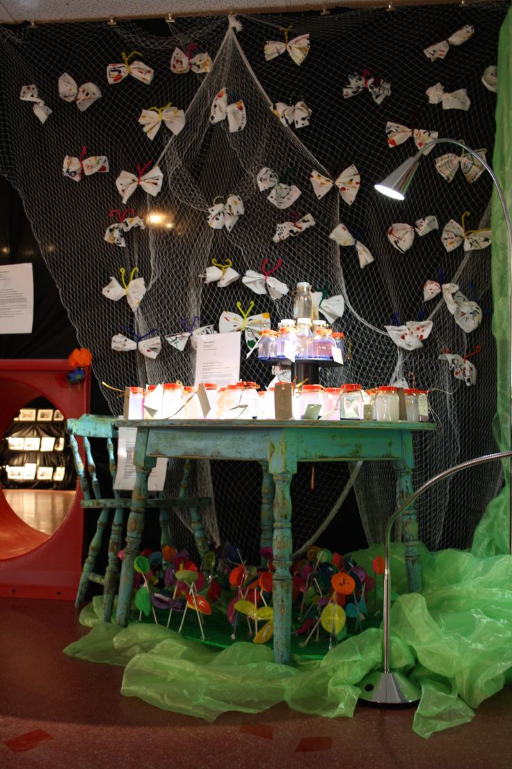 Primary School Art Show. Alice in Wonderland inspired. Paper towel butterflies. Talking Flowers under the table. Calm Me glitter jars no table All by Preps.