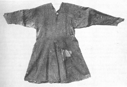 1100 AD (app), the Kragelund tunic, Denmark. Found on a bog body. The man also wore short boots on his feet, but had bare legs. The boots are not preserved.