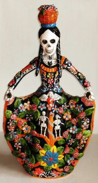 Talavera Catrina wearing tree of life dress. La Calavera Catarina styled in Talavera with Arbos de Vida.