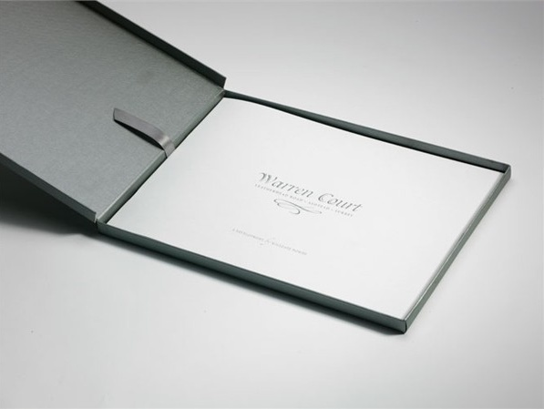warren Court property, hinged box folder with ribbon and silver foil
