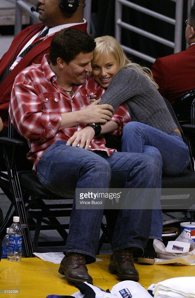 Actor David Boreanaz and wife actress Jaime Bergman attend the game between the Los Angeles Lakers and the Utah Jazz on March 28, 2004 in Los Angeles, California.