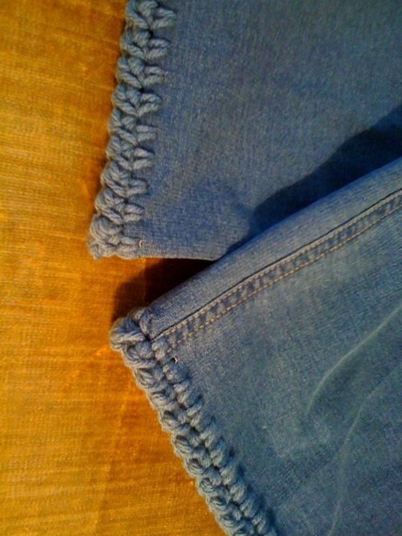 Crocheted border on jeans. Great idea when shortening jeans instead of a typical sewn hem.