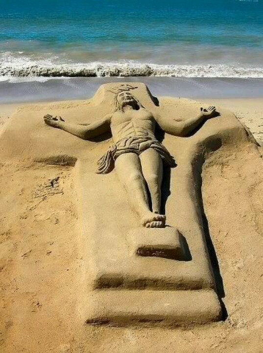 Jesus on the cross made of sand.