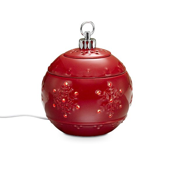 """Christmas Traditions ScentGlow® Warmer  Item #:  P90778  Let this classic Christmas icon fill your home with wonderful fragrance. Our electric ceramic warmer uses a warming plate to release the fragrance of Scent Plus® Melts, or scented oil,  sold separately. Hidden LED provides a welcoming glow. Includes three glazed ceramic pieces. Use without the lid for a stronger scent. 6"""" h, 5"""" dia.   Reg Price:  $35.00 each  Sale Price: $12.00 each"""