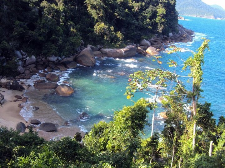 """Cairuçú beach. This one is located in Paraty-RJ. It's desert, only one family lives here and you can camp there. There are two ways to reach it, from Paraty only by boat. There is also a trail named """"Joatinga trail"""", wich takes 3 to 4 days and goes from """"Pouso da Cajaíba"""" to """"Laranjeira Village"""", Cairuçú is on the middle of the way.  Fantastic, for me is the most beautifull beach of the trail."""