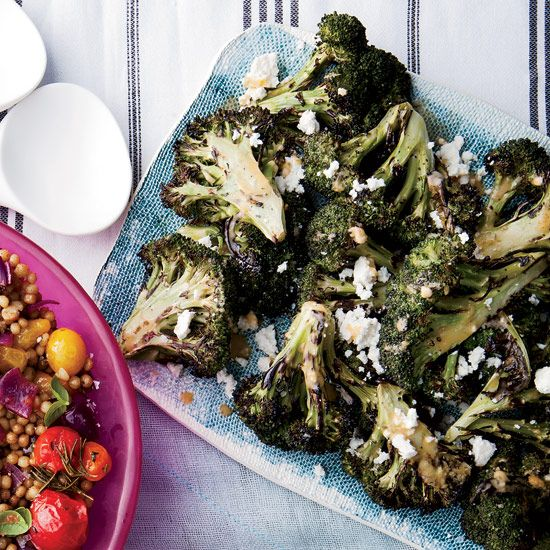 Grilled Broccoli with Chipotle-Lime Butter and Queso Fresco | If you've never tried grilling broccoli, you are definitely missing out: The vegetable becomes tender and deliciously charred.
