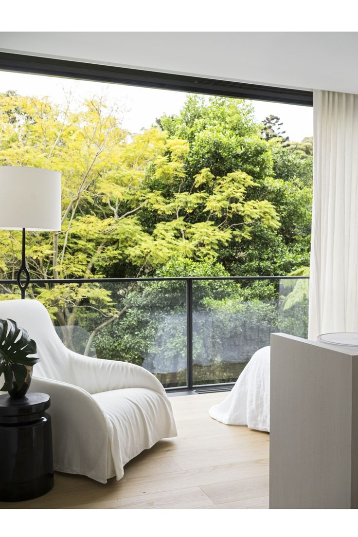 Tobias Partners - Cooper Park House. In the guest bedroom, Maxalto 'Kalos' armchair by Antonio Citterio from Space. 'Amanda' floor lamp from Christian Liaigre.