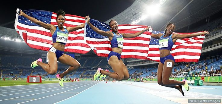 (L-R) Bronze medalist Kristi Castlin, gold medalist Brianna Rollins and silver medalist Nia Ali celebrate with American flags after the women's 100-meter hurdles final at the Rio 2016 Olympic Games at the Olympic Stadium on Aug. 17, 2016 in Rio.