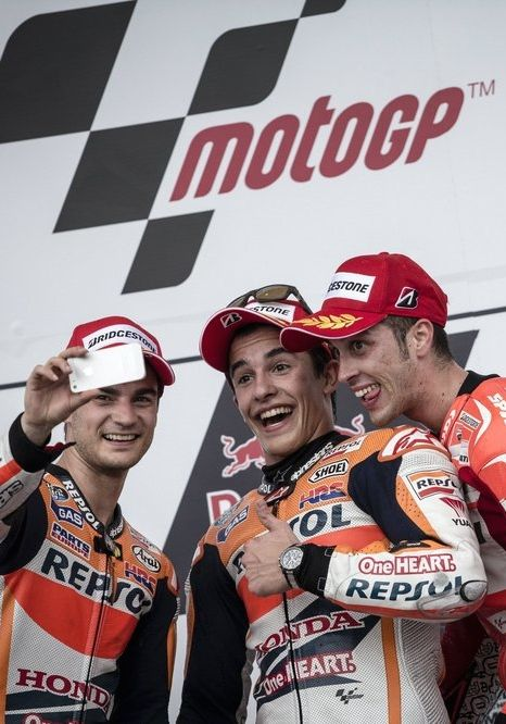 One for the scrapbook:  Marc Márquez (centre) in a podium selfie having won the MotoGP of the Americas