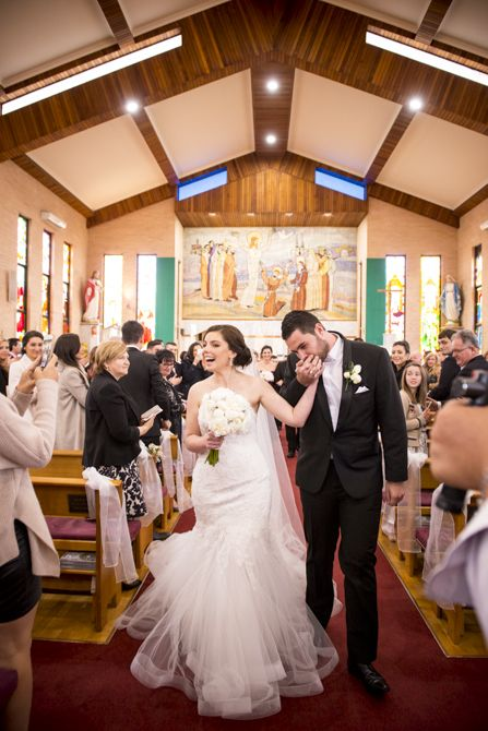 I love the joy and love in this shot. Captured while applause was ringing through the church as the bride and groom made their exit after being pronounced husband and wife. Location: St Nikola Tavelic Croatian Catholic Church, St Johns Park #sydneywedding #croatianchurch #weddingphotographer #sydneyweddingphotographer #bride #groom #weddingdress #suzannablazevic