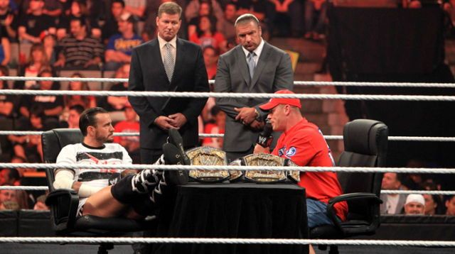 C.M. Punk vs. John Cena contract signing, with Triple H and John Laurinaitis