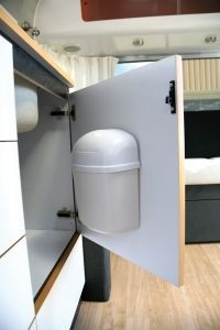 This wall mount trash can is the perfect way to save space in your RV.