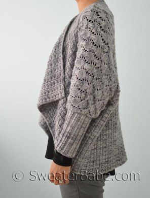 Wrap yourself in this luxe, multi-textured, supremely soft cardigan. With its generous dolman sleeves, open draped front, and the option of wearing it upside-down for a shawl collar, this cardigan will be your ultimate go-to piece.Simple shaping starts with long rows of an easy-to-learn lace pattern that transitions into a slightly different, more delicate lace. Then, stitches are picked up along the cast-on edge to knit down using a wide twisted rib stitch pattern that looks great on both…