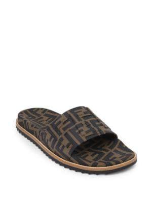 90e1d085e8fb Shop FENDI Men S Rubber Pool Slide Sandals W  Raised Logo Detail ...
