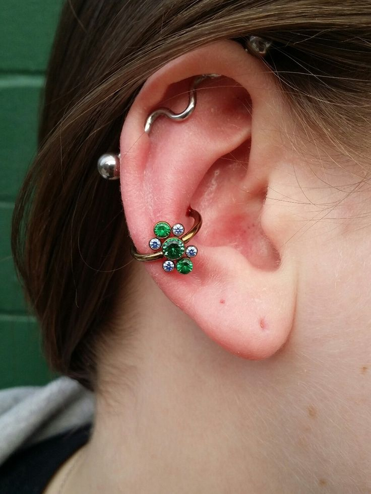 Conch piercing performed with all titanium jewelry from anatometal.