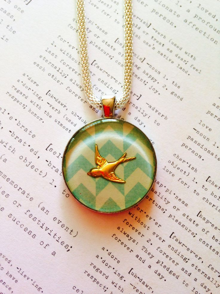 Chevron Bird Resin Pendant on Silver Coloured 'hollow' chain. $35