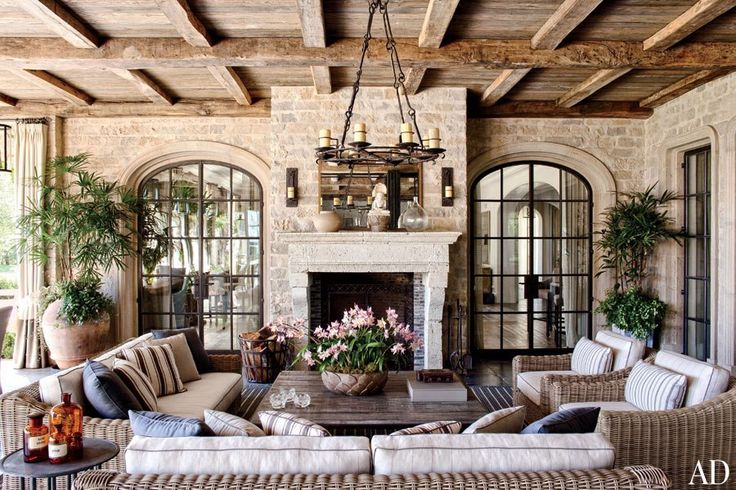 Gisele Bündchen and Tom Brady's Los Angeles Home, Chandelier and sconces by Gregorius Pineo., Reclaimed oak ceiling beams and antique limestone mantel ,