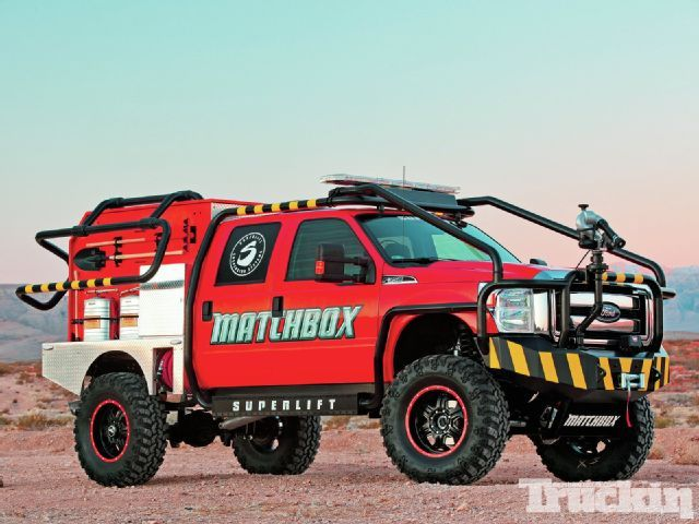 """Apocalypse Now - Superlift & Matchbox's F-350 is ready for anything. When we asked Superlift's Director of Marketing Joey Arbogast why they created this big brush truck, he replied, """"It just seemed like a cool idea, plus Matchbox offered to make a replica toy of the truck if we did it, and they did."""""""