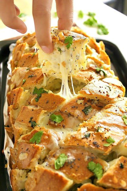 STUFFED ITALIAN BREAD 1 Italian loaf, 1 stick butter, melted 1/8 cup olive oil 3 tsp minced onion 2-3 cloves garlic, grated 1 tbsp dijon mustard 1 tbsp poppy seeds 3 tsp chopped parsley,12 oz grated cheese, 350 oven. Mix the melted butter, olive oil, onion, garlic, mustard, poppy seeds and parsley in a bowl. Cut the bread into cubes with X slice, almost to bottom. Fill cracks. Wrap loaf with foil, sealing the sides. Bake 15-20 min. Unwrap, bake 10 more min.