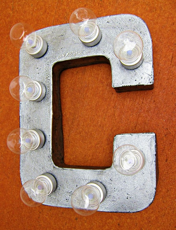 "DIY Marquee Letters, Paper Mache Crafts...pinned this because this is a wireless version. Use battery tea lights and Christmas ball glued on top to make ""lightbulbs""."