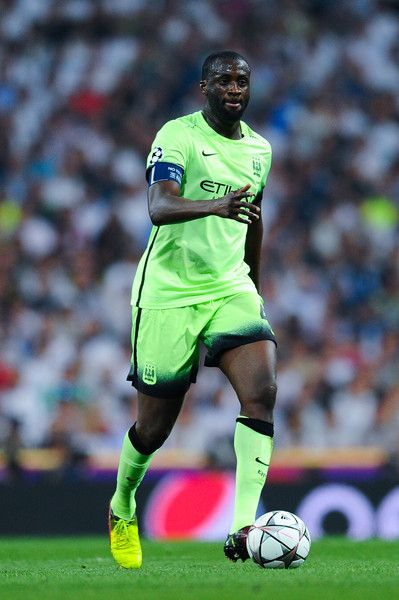 Yaya Toure Photos - Yaya Toure of Manchester City FC runs with the ball during the UEFA Champions League Semi Final second leg match between Real Madrid and Manchester City FC at Estadio Santiago Bernabeu on May 4, 2016 in Madrid, Spain. - Real Madrid v Manchester City FC - UEFA Champions League Semi Final: Second Leg