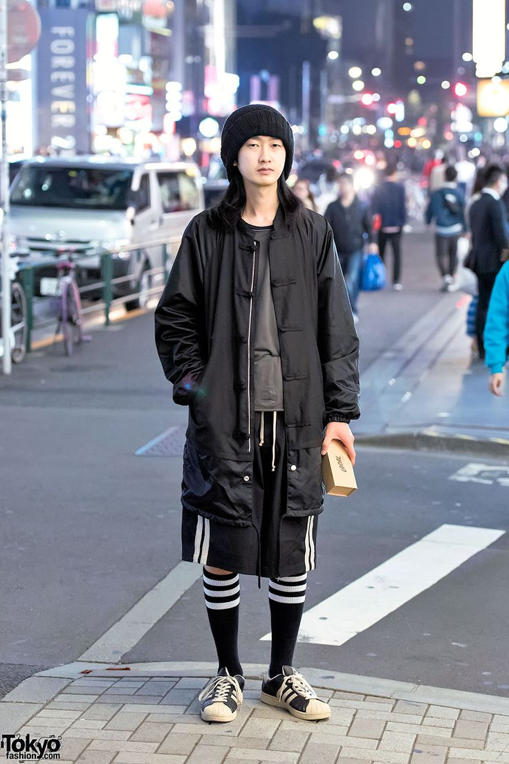 Itoo on the street in Harajuku wearing a Kidill jacket over a Rick Owens top and Rick Owens shorts, Adidas sneakers, and a Juvenile Hall Rollcall x Jun Mikami knit cap.