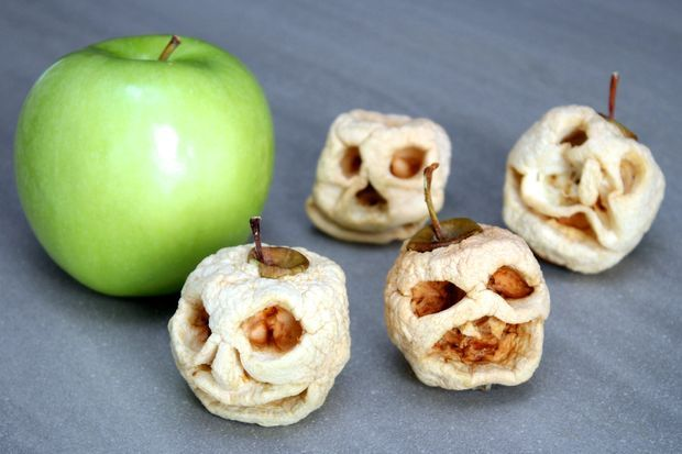 Halloween decorations, more than a tasty treat. Try making these shrunken apple heads as a part of a table centrepiece.