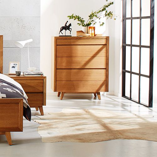 Give your bedroom a modern edge with this mid-century inspired suite. The pieces are Australian made from Tasmanian Oak.  Pictured: Retro Bedside Table and Five Drawer Tallboy.