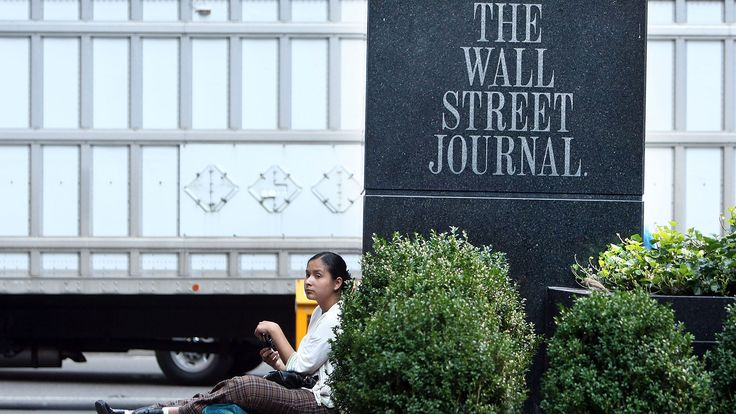 A group of Russian hackers infiltrated the servers of Dow Jones & Co., owner of the Wall Street Journal and several other news publications, and stole information to trade on before it became public, according to four people familiar with the matter.
