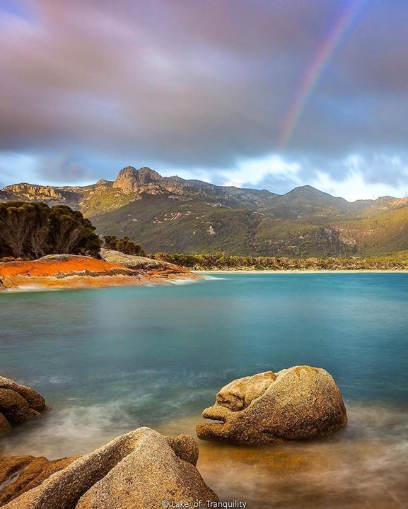 Hotels-live.com/pages/sejours-pas-chers - Golden light and an afternoon rainbow framing the bouldered peaks of Flinders Island's Strzelecki Range in this magical shot from @lake_of_tranquility. @visitflindersisland is the main island in the Furneaux Group a chain of 54 islands in the wild waters of Bass Strait off of Tassie's north-eastern shores. The island is home to a wealth natural beauty including Strzelecki National Park's spectacular coastal and granite mountain landscapes. The park…