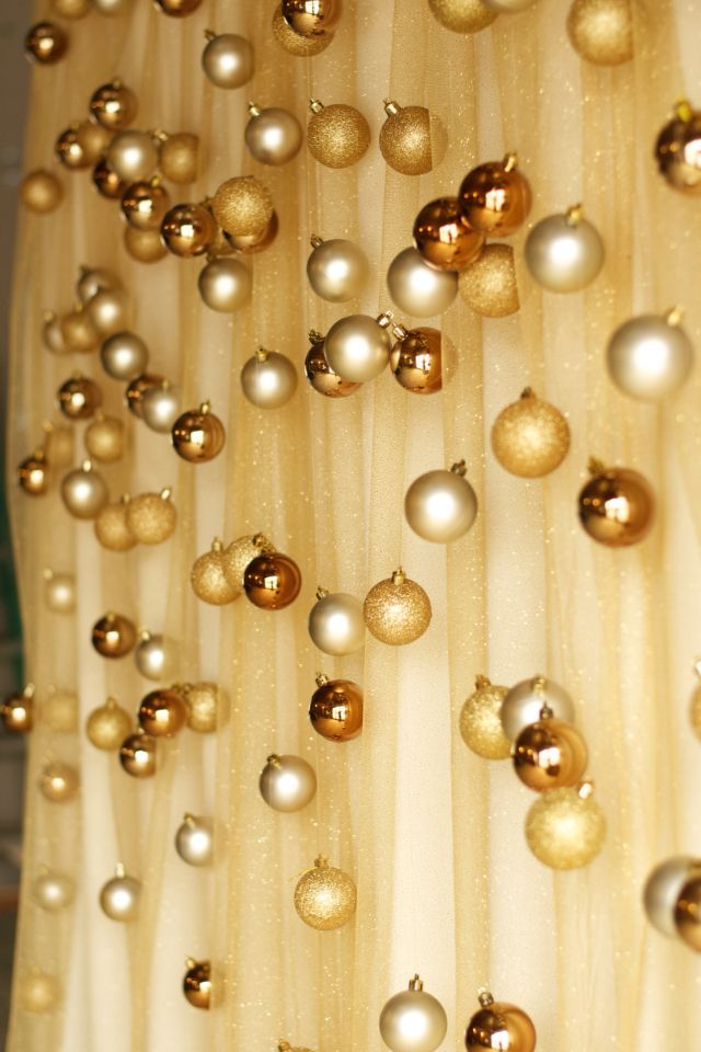 Fabric and ornaments as a backdrop. Quick and easy DIY project, perfect for a Christmas party.