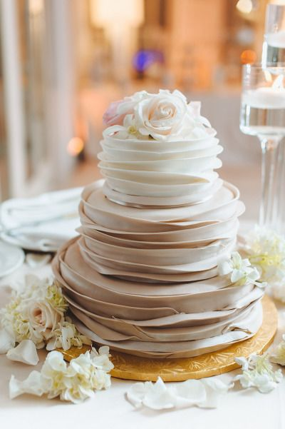 Champagne hued cake: http://www.stylemepretty.com/florida-weddings/2014/09/26/elegant-south-florida-wedding-at-seagate-beach-club/ | Photography: Mango Studios - http://mangostudios.com/