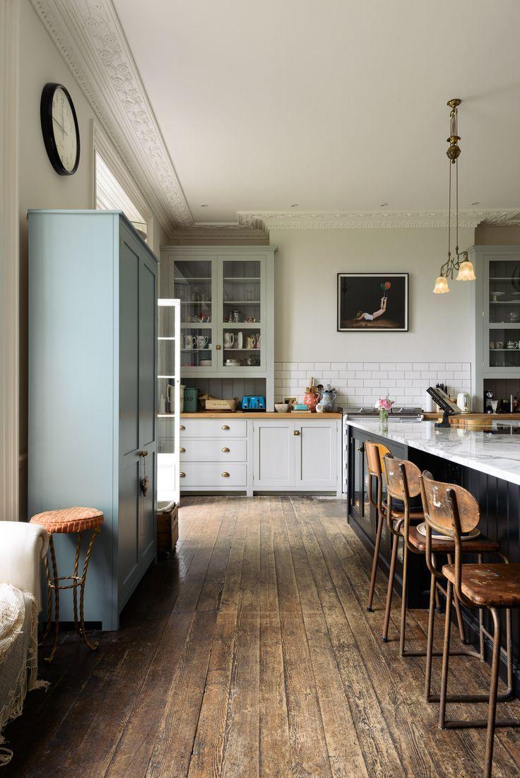 Original dark wooden floors and a beautiful mix of deVOL Classic English and Shaker kitchen furniture.