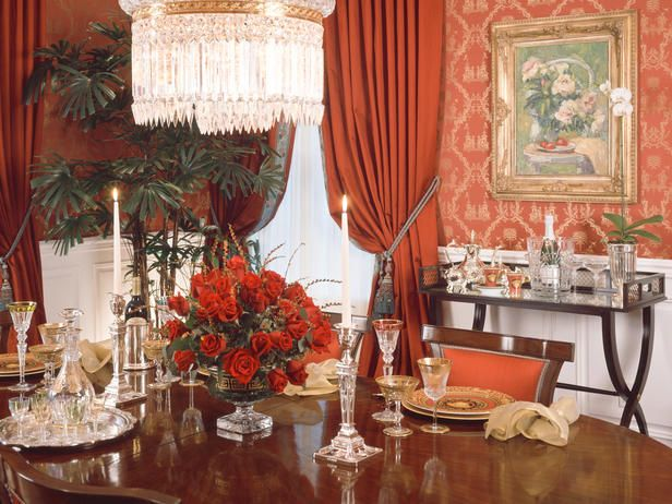A baccarat chandelier was the centerpiece for this beautiful traditional dining room. Red silk upholstered walls with teal accents highlight the space.