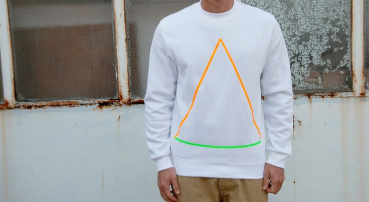 Sweatshirt Color: White 80% Cotton 20% Polyester Design: Neon Orng Triangle