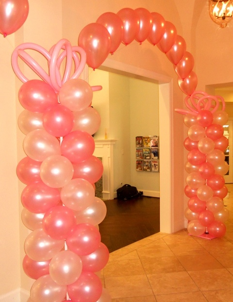 pink balloon columns and string of pearls helium arch