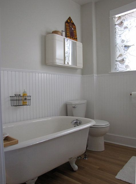 Bathroom: bright & airy, whites, grays, light blue, natural materials such as wood, cork, and sea grass. Antique jars for storage, hits of color through plants, linens, and artwork.