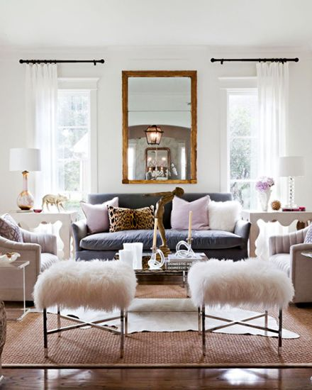 Feminine living room with furry stool and leopard print pillow
