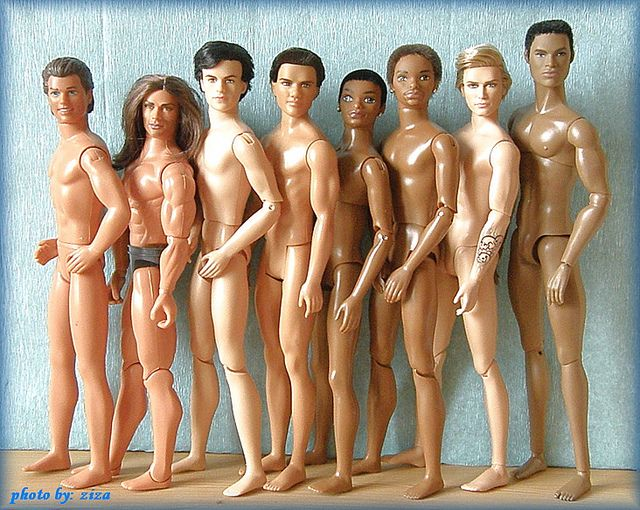 It's interesting to see the body sculpts for these Kens.  Rio Ken, Jude Deveaux Ken, Speed Racer Ken, Twilight Jacob Ken, 2 Flavas Tre, Harley Davison Ken, and a male doll from Intergrity Toys/Fashion Royalty doll (this is not my collection, but I think I got this right).