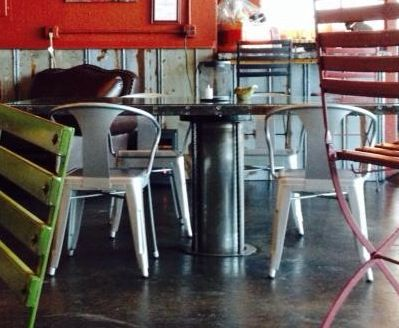 This table is in a repurposed auto repair shop. The table is up-cycled from the car lifter.