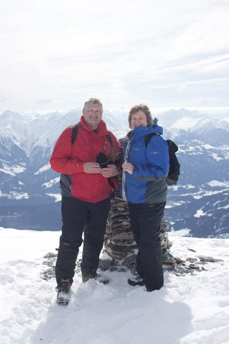Greg and Amanda at the top of Fil de Cassons 2675m, Switzerland in the winter snow and sunshine, overlooking the village of Flims, Graubunden . We were On Top of the World - Quite Literally!