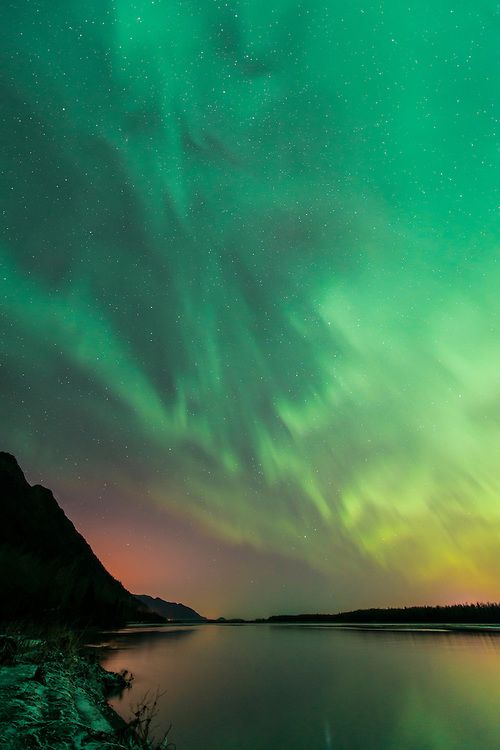 Autumn aurora borealis over Knik River and the Chugach Mountains near Palmer, Alaska.Copyright Carl Johnson