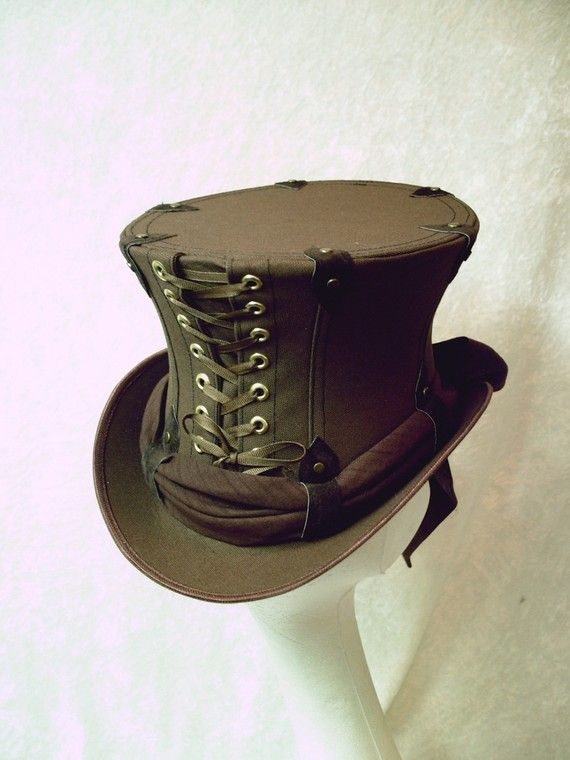 Custom Made Chocolate Canvas Captain Spaulding Lace-Up Top Hat. I'm not sure where I would wear it, but that doesn't stop me from wanting it. $145