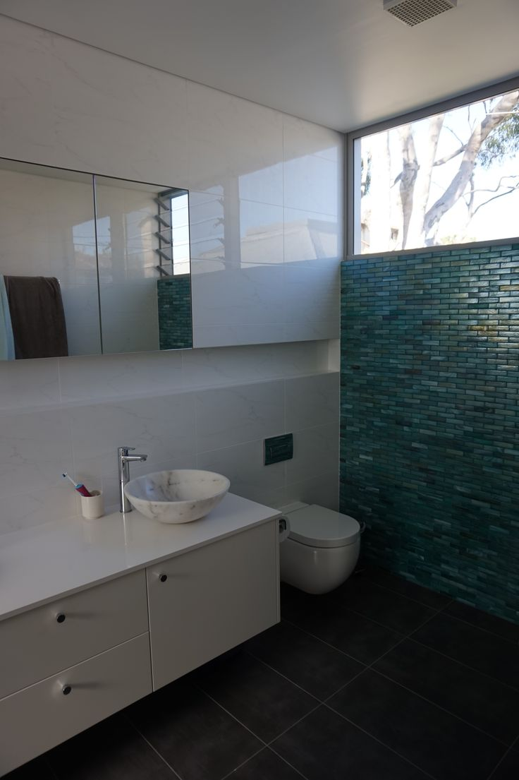 Ensuite bathroom Wall hung vanity concealed cistern mirror shaving cabinet and recessed space